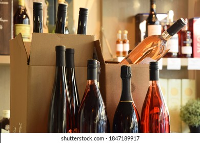 Wine bottles in wine store and ready for home delivery