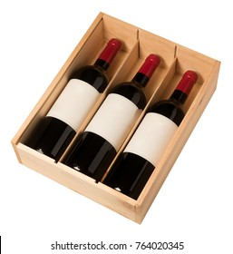 Wine bottles in wooden box isolated on white background, France