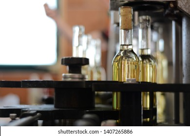 wine bottling process, bottles of wine on a winery conveyor. wine making process concept