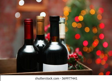 Wine in box on blurred Christmas tree background