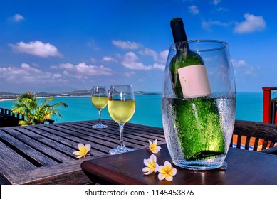 Wine by the sea, fine wines are soaked in an ice bucket with a glass of wine ready to drink on Amazing view the sky is blue the sea is green.Chaweng beach KOH Samui Thailand