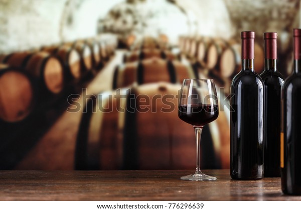 Wine cellar with wine bottle and glasses.with space for text