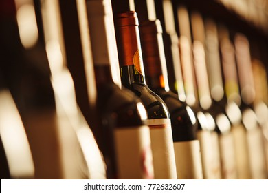 Wine cellar with elite drinks on shelves with written names