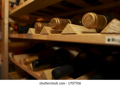 Wine cellar with sauternes bottles, partially blurred