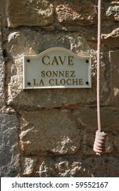 wine cellar sign and ring the bell cord