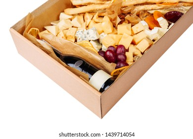 Wine Cheese Carton Box Isolated Delivery Closeup. Gourmet Fruit and Drink with Blank Label Set in Paperboard Gift Package on White Background. Brie, Camembert and Cheddar Big Cheeseboard