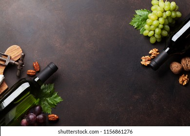 Wine, cheese, grape and nuts. Top view with space for your text