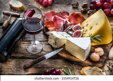 Wine Cheese Meat on rustic wooden table