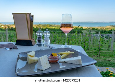 Wine, cheese table over the Lake Balaton on the hill Dinner, lunch, romantic date, picnic, eating on nature. Csopak wine restaurant