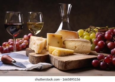 Wine, cheeses and grapes in a vintage setup.