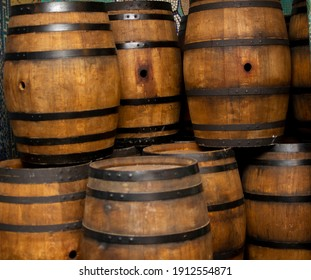 Wine and cognac oak barrels with metal hoops Stand on top of each other in several rows.