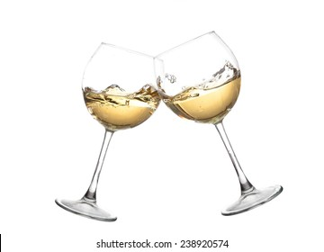 Wine collection - Cheers! Clink glasses with white wine. Isolated on white background. Toasting gesture two white wine glasses with big splash