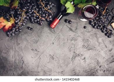 Wine composition on dark rustic background