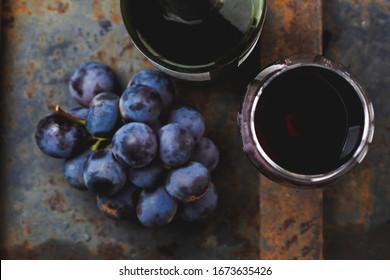 Wine concept - wine, grape on rustik dark background. top view
