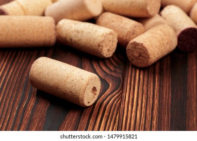 wine corks on a dark wooden background texture with a place for text.