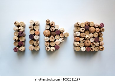 Wine corks pause, play and stop button shapes isolated on white background from a high angle view