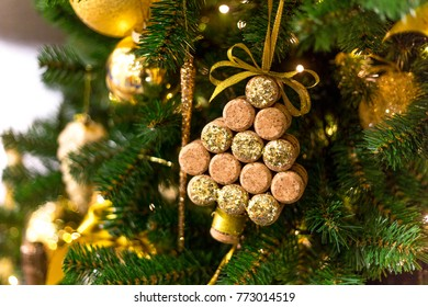 wine corks in the shape of a Christmas tree, hanging on the pine branches, toy