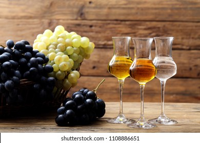 wine distillate in glass rustic background