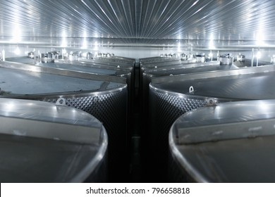Wine factory tanks under a stainless steel seiling