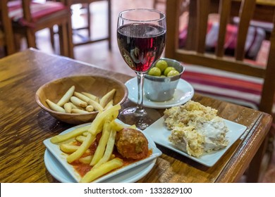 Wine glass and assorted tapas in a bar in Algeciras, Andalusia, Spain
