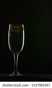 wine glass black background counter light grapes