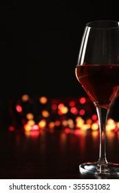 Wine glass with bokeh on dark background