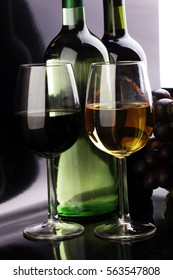 Wine glass and Bottle on black background. Red and white wine
