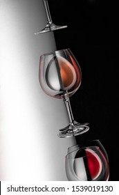 wine glass with wine corks on black wood background Poster concept design photo shooting