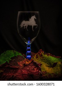 Wine Glass with an Etched Horse in a Bed of Grape Leaves