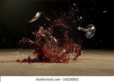 Wine glass exploding on concrete