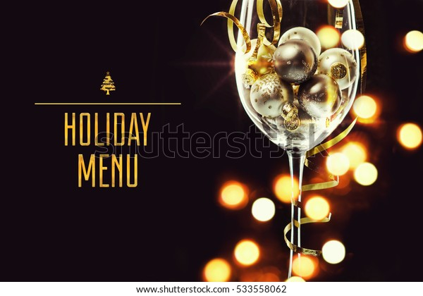 Wine glass filled with christmas balls. Holiday menu concept
