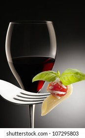 wine glass and fork with macaroni