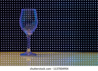 Wine glass in front of led lights. High quality and high resolution image with 300DPI.