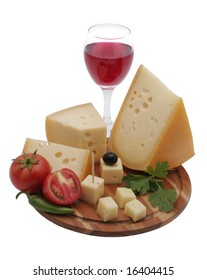 Wine in a glass, grapes and cheese