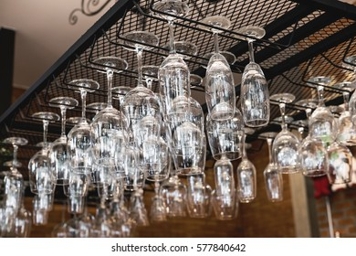 Wine glass hanging oh shelf in pub & restaurant
