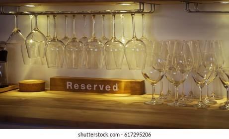 Wine glass hangs on a glass rack.