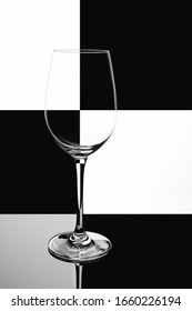Wine glass on black and white domino background. phone wallpaper.