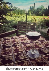 a wine glass on table at garden in summer