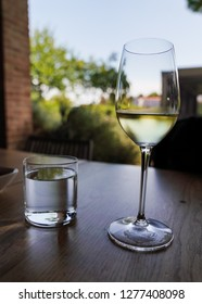 Wine Glass on table and landscape