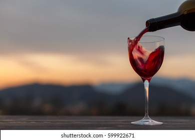 Wine in a glass outdoor, blurry