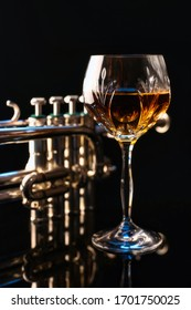 Wine Glass with Piccolo Trumpet in the Background