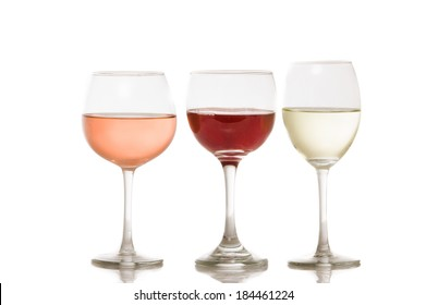 wine and a glass pouring on a white background