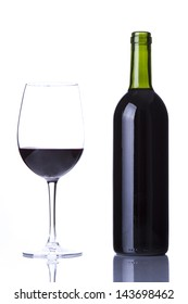 wine glass with red wine and bottle of wine