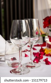 Wine glass table set with rose petals decorations on Valentine events
