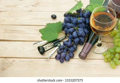 wine in glass,bottle and grapes with leaves on wooden background, with  copy space