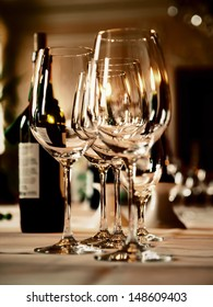 wine glasses and a bottle on a table