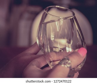 Wine glasses clinking to toast at a winery