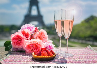 Wine glasses and Eiffel tower in Paris, springtime