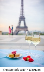 Wine glasses and Eiffel tower in Paris spring