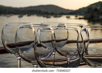 Wine glasses in front of a sunset